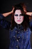 Madness. Mad girl with clown make-up Royalty Free Stock Photography