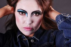 Madness. Mad girl with clown make-up Stock Photos