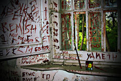Madness. Written on the walls in an old abandoned mental hospital Royalty Free Stock Images