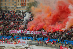Madness. Spartak soccer team fans from Moscow are the most notorious and agressive fans in Russia. The banner the fans are holding says: Your Judgement day has Stock Photos