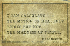 Madness of people Newton. I can calculate the motion of heavenly bodies - ancient English physicist and mathematician Sir Isaac Newton quote printed on grunge Royalty Free Stock Photo