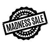 Madness Sale rubber stamp. Grunge design with dust scratches. Effects can be easily removed for a clean, crisp look. Color is easily changed Stock Photos