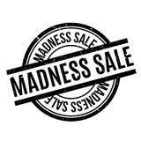 Madness Sale rubber stamp. Grunge design with dust scratches. Effects can be easily removed for a clean, crisp look. Color is easily changed Royalty Free Stock Image