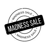 Madness Sale rubber stamp. Grunge design with dust scratches. Effects can be easily removed for a clean, crisp look. Color is easily changed Stock Photo