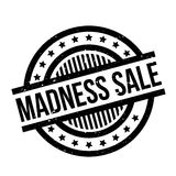 Madness Sale rubber stamp. Grunge design with dust scratches. Effects can be easily removed for a clean, crisp look. Color is easily changed Royalty Free Stock Images