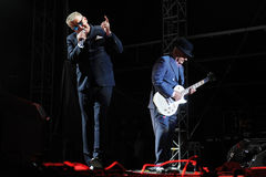 Madness. Singer Graham McPherson alias Suggs (L) and guitarist Chris Foreman (R) of famous British band Madness during performance at festival Rock for People in Stock Photography