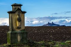 Madona and Castle. Cross with Madonna in the background with the landmark Bohemian Paradise Stock Photos