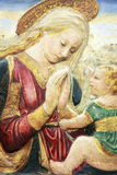 Madonna and Child. A tempera painting of the Madonna and Child after Desiderio by an unknown Italian medieval painter created in the 15th century Royalty Free Stock Photos