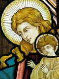 Madonna and Child. A stained glass window of Virgin Mary and baby Jesus Stock Images