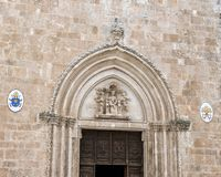 Madonna and Child above the entrance of the Ostuni Cathedral. Pictured is a closeup view of the top of the entrance to  the 15th Century Ostuni Cathedral.  The Stock Photo