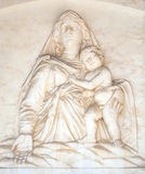 Madonna with the Child. By Andrea Gurdi lunette over the portal of Cathedral in Pisa, Italy. Unesco World Heritage Site Stock Images