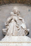 Madonna and Child. Lunette of San Petronio Basilica by Jacopo della Quercia in Bologna, Italy Royalty Free Stock Photography