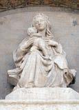 Madonna and Child. Lunette of San Petronio Basilica by Jacopo della Quercia in Bologna, Italy Stock Photo