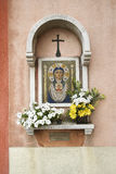 Madonna and Child Mosaic at Outdoor Shrine. Flowers have been left at the shrine. Vertical shot Royalty Free Stock Photography