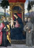 Madonna with the Child and saints. The fresco Madonna with the Child and saints by Aiuto del Pinturicchio 1489 - 1491 in Basso della Rovere chapel in Church of Stock Photos