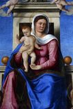 Madonna and Child on the throne. Girolamo da Santa Croce: Madonna and Child on the throne, Altarpiece in Church of the Assumption of the Blessed Virgin Mary in Stock Image