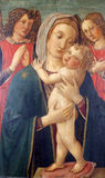 Madonna with Child and two angels Royalty Free Stock Photo