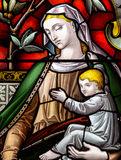 Madonna and Child. Virgin Mary with Baby Jesus stained glass religious photography Royalty Free Stock Photo
