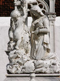 Madonna with Children. Marble sculpture of a Madonna with children Royalty Free Stock Photography