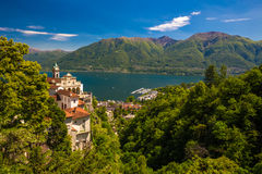 Madonna del Sasso Church in Locarno city, lake Maggiore (Lago Maggiore) and Swiss Alps in Ticino, Switzerland. Stock Photos