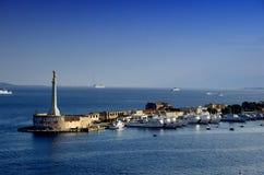 Madonna della Lettera gold statue at the entrance of the Messina port in Sicily stock photo