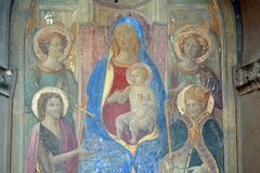 Madonna Enthroned with Saints and Angels, fresco, corner of Via della Scala and Piazza Santa Maria Novella in Florence. Madonna Enthroned with Saints and Angels royalty free stock photos
