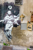 Madonna with gun. Naples, Italy,  - January 17, 2016: Full view of the placed artwork by artist Bansky in  gerolomini square, painted in 2013 Stock Photo