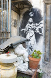Madonna with gun. Naples, Italy,  - November 11 2015: view of the placed artwork by artist Bansky in  Gerolomini square, painted in 2011 Royalty Free Stock Photo