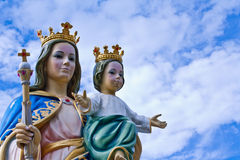 Madonna and Jesus child. With blue sky Stock Images