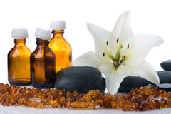 Madonna lily spa stones Royalty Free Stock Images