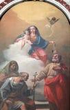 Madonna med barnet och helgon arkivbild
