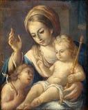 Madonna mit Kind und Johannes der Baptist Stockbilder