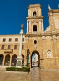 Papal Basilica Cathedral of Brindisi, Apulia, Italy. Madonna Pellegrina stare and Belfry of Papal Basilica Cathedral & x28;Pontificia Basilica Cattedrale della stock photography