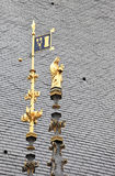 Madonna statue on the roof ofhospice in Beaune Stock Photo