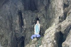 Madonna statue in Serrai di sottoguda canyon. Veneto, Italy. Stock Image