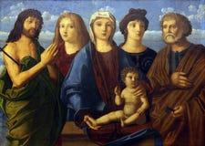 Madonna y niño St John el Bautista y el Peter y los donantes foto de archivo