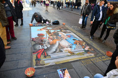 Madonnari artist. NAPLES, ITALY-DECEMBER 25: in the center of the latest madonnari paint the sidewalks of the city on December 25.2012 in Naples-Italy Stock Images
