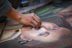 Madonnari street art. Hand painting with chalks on the pavement Stock Images