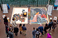 A Madonnaro artist at work in Sydney. SYDNEY,AUSTRALIA - MAY 30,2015: A crowd gathers at Circular Quay to watch artist Pepe Gaka at work. Pepe is a Madonnaro Royalty Free Stock Photography