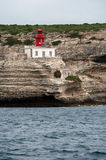 Madonnetta - red lighthouse on Corsica island Royalty Free Stock Photo