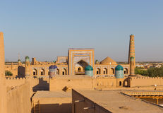 The madrassah of Muhammad Rahim-khan in Khiva, Uzbekistan. View of the madrassah of Muhammad Rahim-khan from the watchtower of the Khuna Ark, the fortress and royalty free stock image