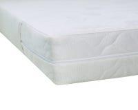 Madrasserna på sängen Arkivfoto