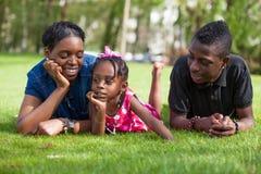 Madre adorable con sus niños en el jardín Imagenes de archivo