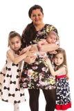 Madre alegre con tres muchachas Fotografía de archivo