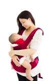 Madre che tiene un bambino Fotografia Stock