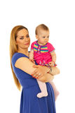Madre con el bebé que mira lejos Fotografía de archivo