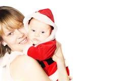 Madre con el pequeño bebé de santa Fotos de archivo