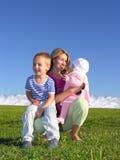 Madre con i bambini Immagini Stock