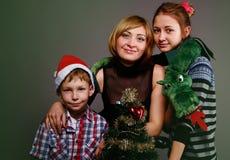 Madre con i bambini su una festa Immagini Stock Libere da Diritti