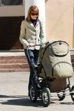 Madre con il carrello di bambino Immagine Stock Libera da Diritti
